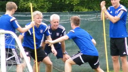 Ipswich Town boss Mick McCarthy watches new signing Jonathan Parr during a training drill in Ireland