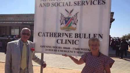 Roger and Linda Bullen beside the clinic sign.