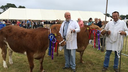 Bob Manning, of New Farm, Cornard Tye, near Sudbury, with his supreme champion in the foreground and