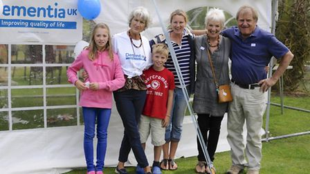Izy Coe, pictured second from left, with friends and family at the garden party held in memory of he