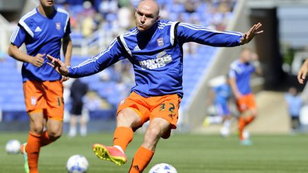 New Town signing Conor Sammon warms up at Reading on Saturday