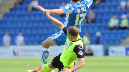 Drey Wright, in action against Oldham, will miss tonight's trip to Charlton with a knee injury