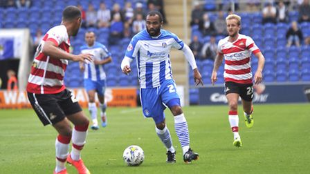 Dominic Vose runs the ball down the pitch during Colchester United's 1-0 defeat to Doncaster Rovers