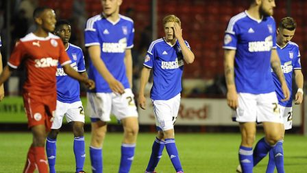 Town players come off the pitch dejected at Crawley Town after losing in extra time
