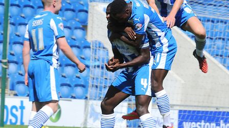 Magnus Okuonghae is mobbed by team-mates after scoring the opener in Saturday's 2-2 draw against Old