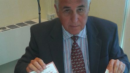 Councillor Roger Walters with cash and entry forms sent to scammers