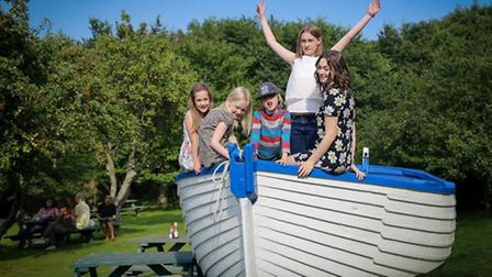 Children exploring the Jill Anne boat at The Ship Inn, Dunwich. Photo by Claire French.