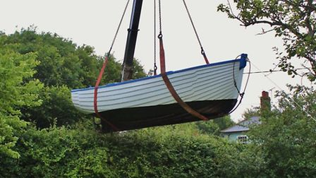 The Jill Anne boat being winched into place at The Ship Inn, Dunwich