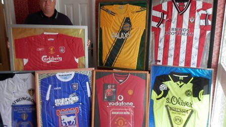 Chris Symes with a selection of the shirts that will be at the auction