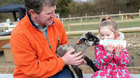 The Amelia-Jane Trust fun day at Nowton Farm Shop. Adele Boothroyd feeds a lamb held by Dave Muskett
