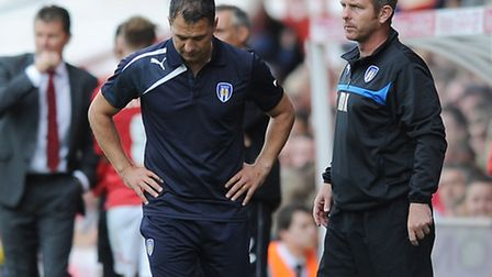 Colchester United boss Joe Dunne and his assistant Mark Kinsella look dejected durign Tuesday night'