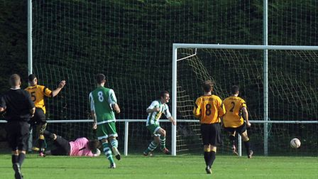 Sam Quinton smashes home Whitton's equaliser in a breathtaking game at Recreation Way on Saturday