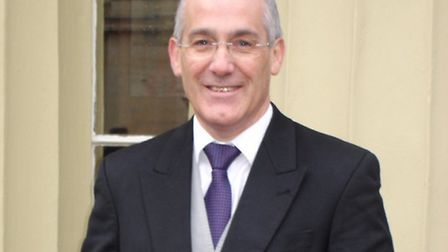 Easton and Otley College principal, David Lawrence, picking up his OBE in 2012.