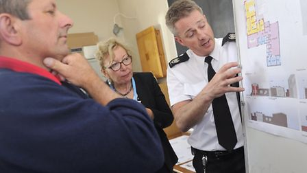 Pc Abigail and Elspeth Gibson, Suffolk County Council Our Place Officer, listen to Carl Francis from