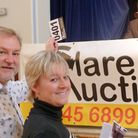 Cllr Alaric Pugh with Vanessa Howard, trustee of the Combined Halls of Clare, with auctioneer Robin