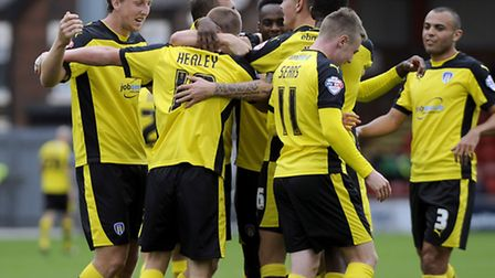 Rhys Healey is mobbed after scoring on his debut at Crewe on Saturday