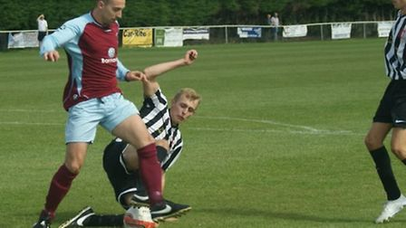 Long Melford (Black & White) in action against Stowmarket earlier this season