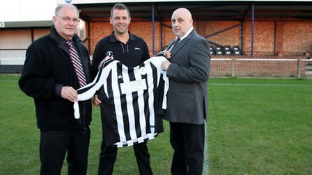 Woodbride Town boss Jamie Scales (centre) poses with club chairman John Beecroft (left) and new spon