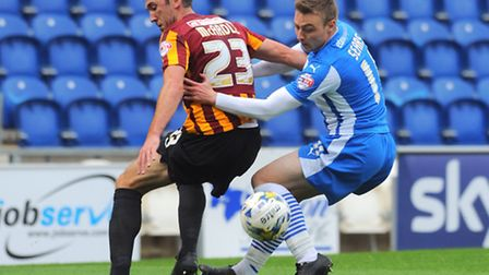 Bradford City's Rory McArdle and the U's Freddie Sears in action during Saturday's goalless draw.