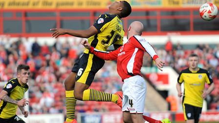 Dominic Smith flicks on a header after coming on as a second-half substitute at Walsall