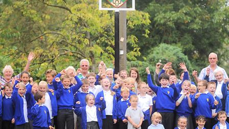 Whatfield win village of the year. Children from Whatfield Primary and local residents celebrating.