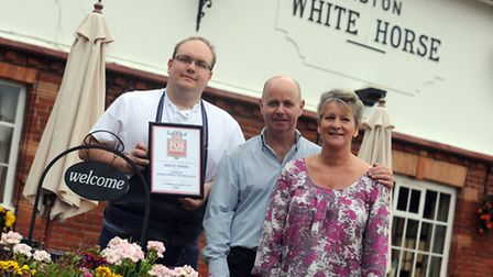 Neil and Gillian Mason with head chef James Finch at the Sibton White Horse. They have just been aw