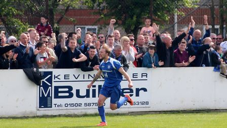 Look at that for passion - Lowestoft's Robert Eagle celebrates a goal with jubilant Trawlerboys' fan