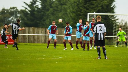 Heading for goal: Action picture of Alex Greggor's superb 35-yard free-kick