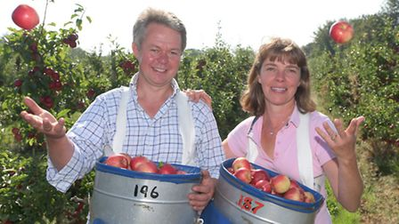 Henry Dobell and his partner Katie Griew at Moat Farm orchard in Kenton, Suffolk