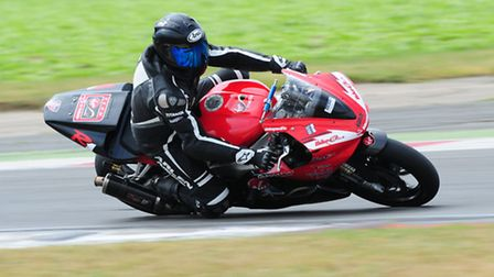 Neil Moss riding his motorcycle