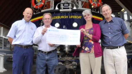 Coxswain Steve Saint from Aldeburgh Lifeboat Station received a £25,000 donation from Dave and Trish