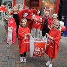 Seven year old Lucy Bluett visits the British Heart Foundation shop in Bury to raise awareness of th