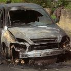 Burnt out car in Acton Lane