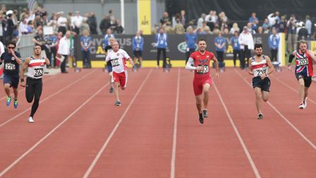 Competitors taking part in the Men's 100m IT3 final, during day two of the Invictus Games Athletics