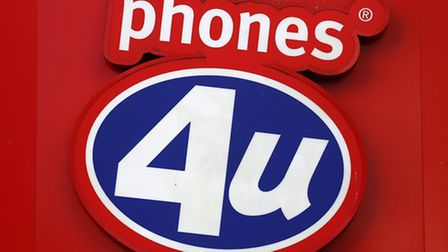 A Phones 4U shop sign. Phone network EE is to buy 58 Phones 4U stores, safeguarding 359 jobs, in a d