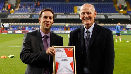 Leiston St Margarets' long-standing John Barker receiving his Volunteer of the Year Award from the S