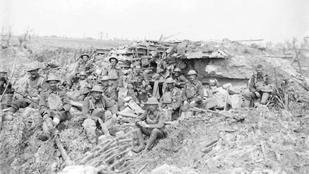 Grenadier Guards outside a smashed German machine gun emplacement at Pilckem, on August 5, 1917. Th