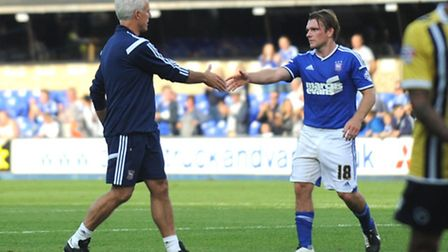 Ipswich manager Mick McCarthy shakes hands with Jay Tabb at the end of Saturday's 2-0 home win over