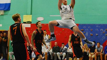 Ipswich's Leigh Greenan throws down a huge dunk against Brentwood