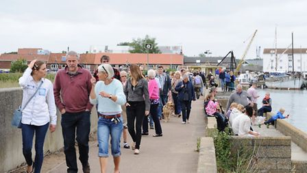 A stretch of the river wall is used by visitors to this year's Woodbridge Regatta