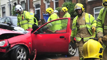 Firefighters at the scene of a car crash. Library image.