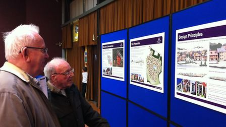 Residents examine the proposals for the homes in Needham Market at an earlier exhibition