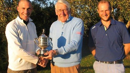 Suffolk PGA captain Frank Hill (centre) presents the Ransome Trophy to Lawrence Dodd after his 4 and