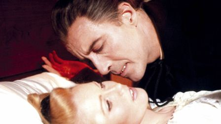 Christopher Lee as Dracula, leans over a potential victim played by Veronica Carlson in Dracula Has
