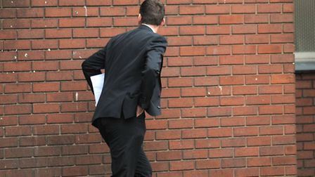 Ian Doyle running away and obscuring his face following his hearing