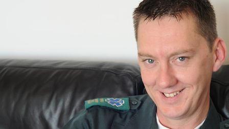 Ian Doyle in his paramedic's uniform after helping deliver a baby in 2011