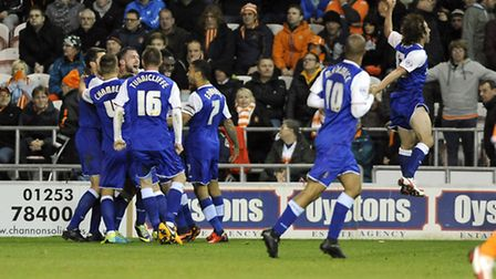 Stephen Hunt (far right) celebrates wildly after Ipswich Town secured a dramatic 3-2 win at Blackpoo