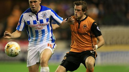 Huddersfield Town's Grant Holt holds off a challenge from Wolverhampton Wanderers' Richard Stearman.