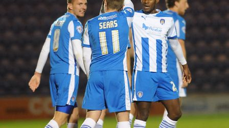 Freddie Sears celebrates scoring the winner with his Colchester United team-mates against Chesterfie