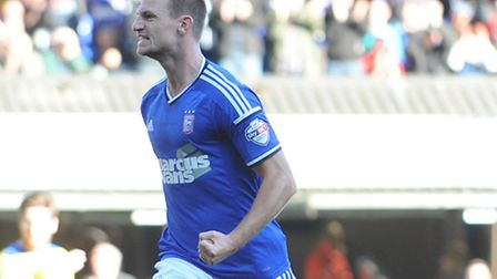 Tommy Smith celebrates after giving Ipswich Town the lead against Huddersfield on Saturday. Photo: S